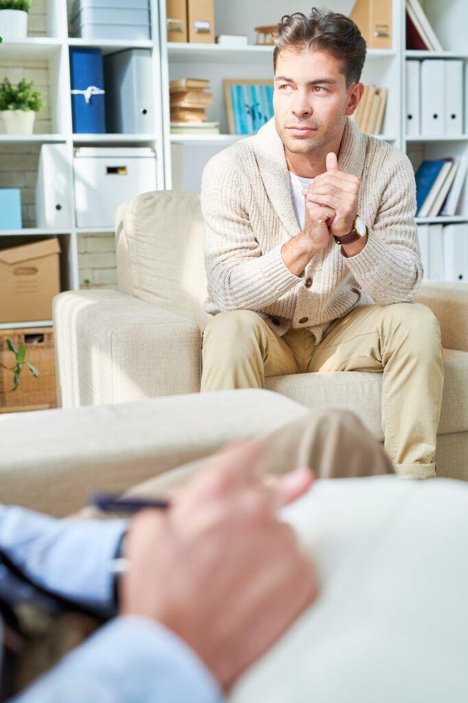 Man Talking to Psychologist